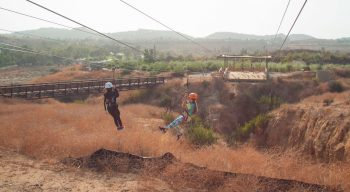 Campers on zip line at Adventure Hill
