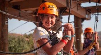 Girl ready to zip line at Adventure Hill