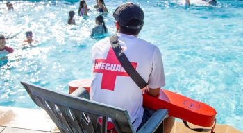 Lifeguard sitting by the pool