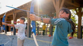 Kids shooting arrows at archery range