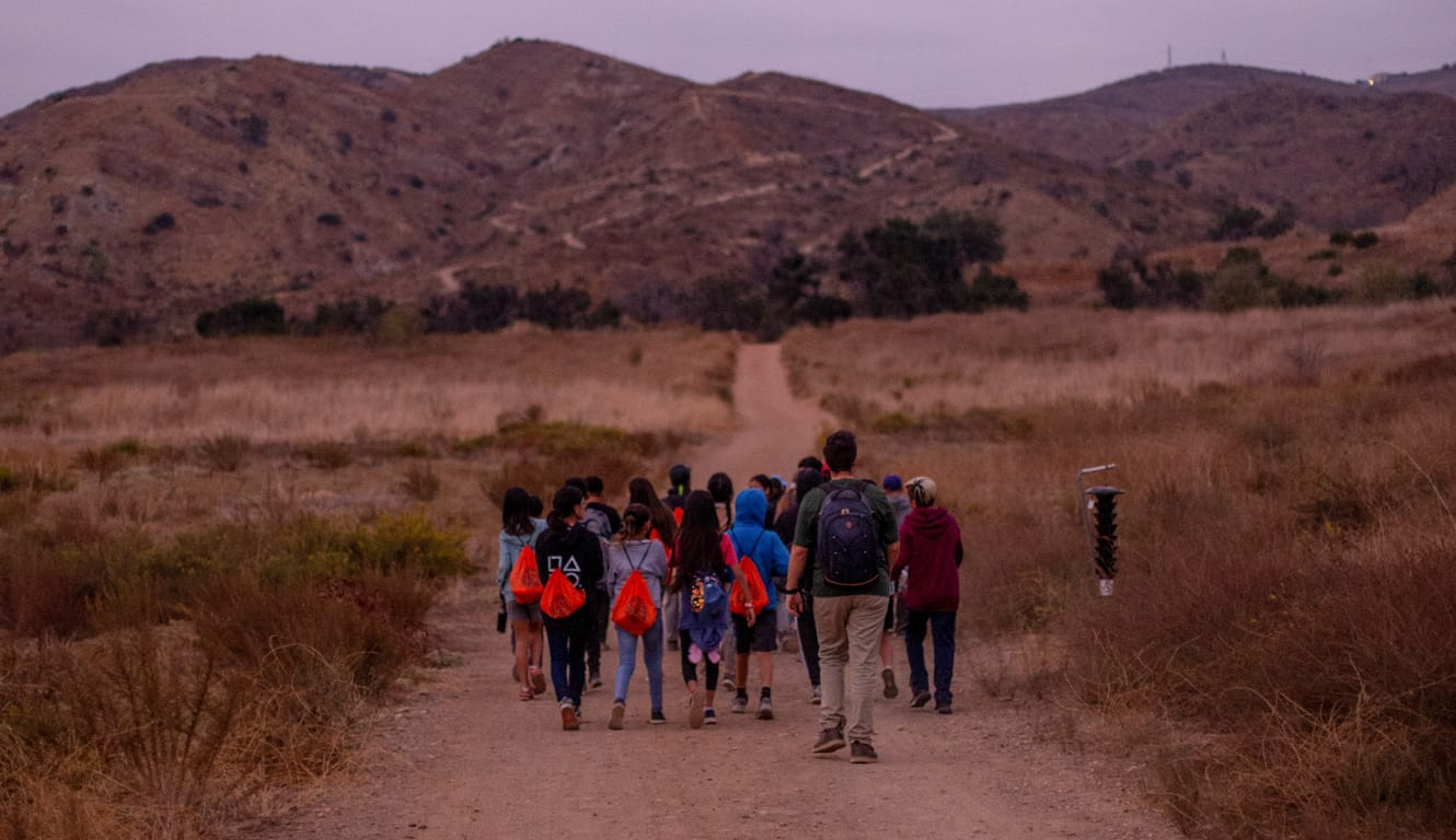 Teens on a night hike during an overnight program