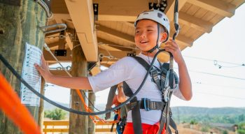 Boy getting ready to zip line