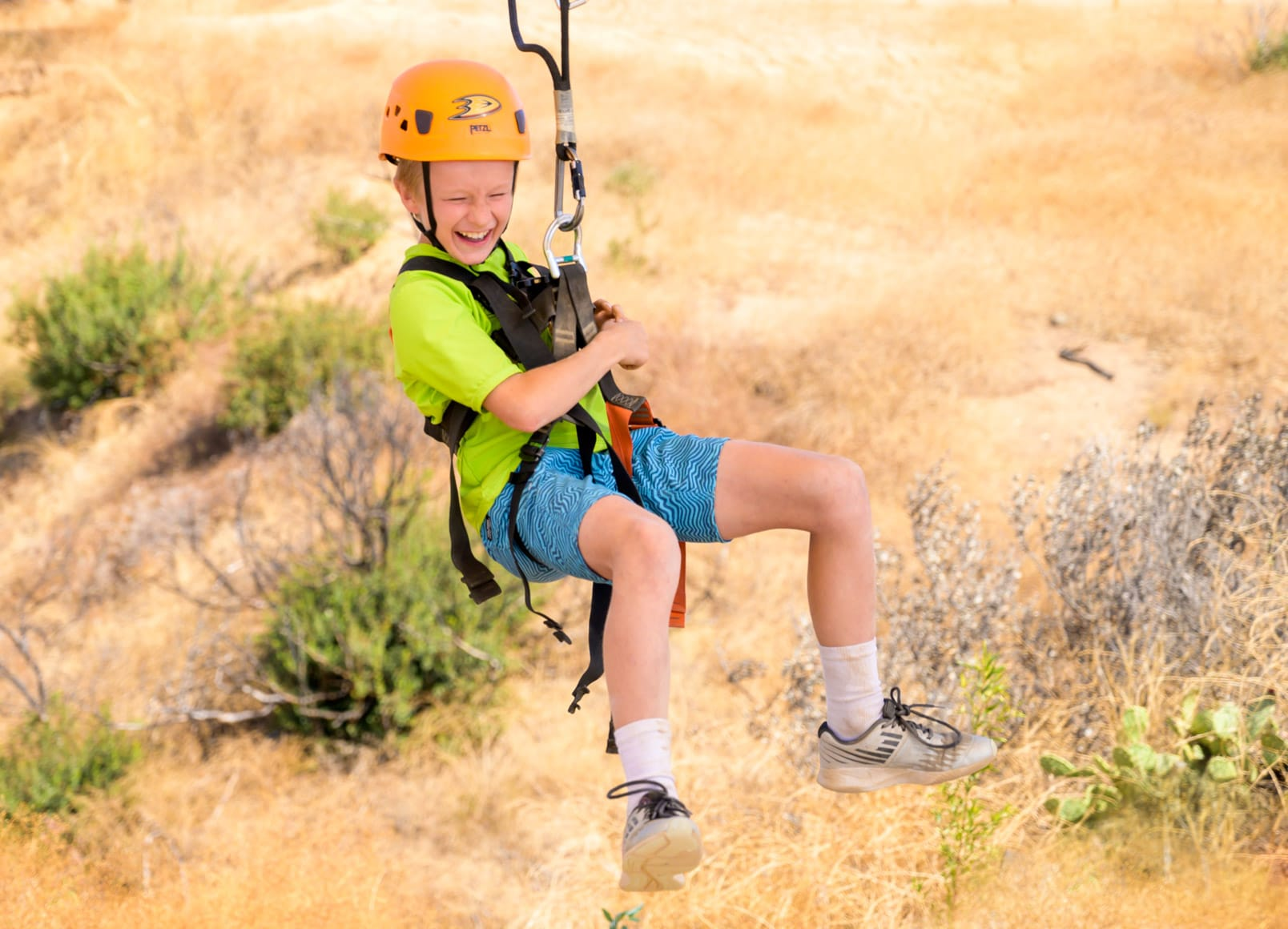 Young boy on the zip line at Adventure Hill